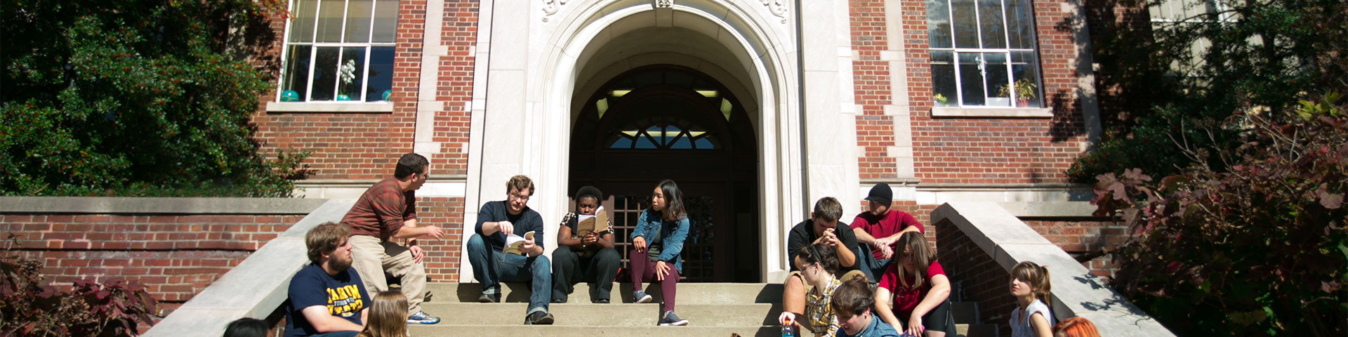 Murray State students attend class on the steps of Wilson Hall