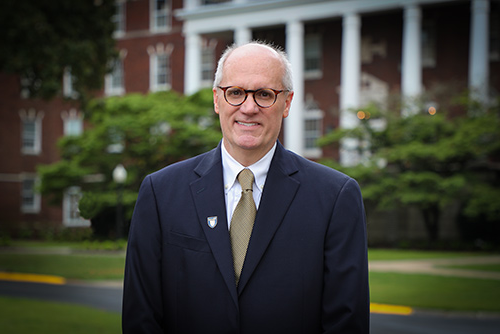 Dr. Bob Jackson in front of Wells Hall